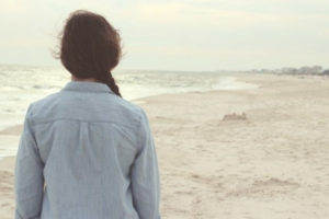 Woman at the beach wistful