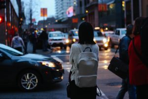 image of woman standing in street