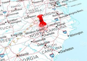 Red Thumbtack Over North Carolina State USA Map. 3D rendering