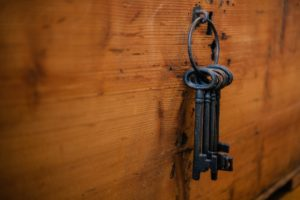 Old fashioned keys hanging on a wall