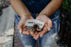 Woman holding handful of change