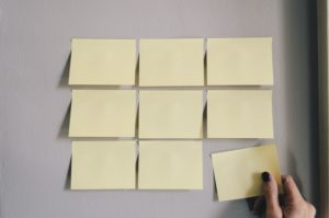 9 yellow post-its on a wall